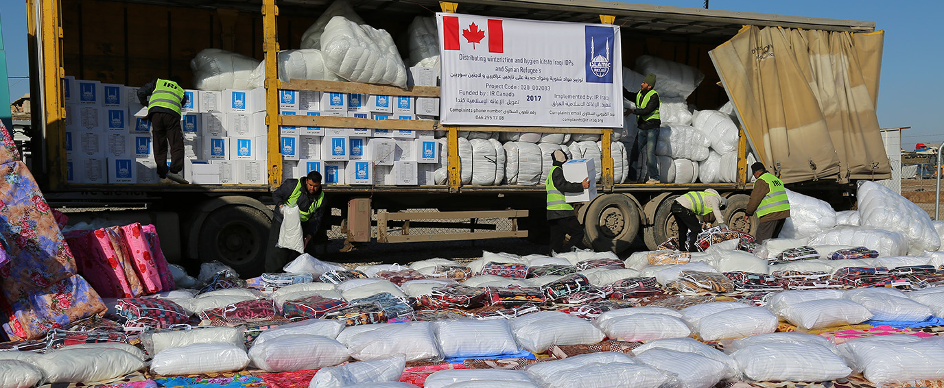 Distributing winterization and hygiene kits to Iraqi IDPs and Syrian Refugee's
